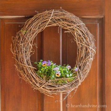 floral living wreath on door.