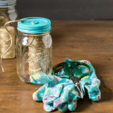 garden gloves scissors and mason jar with jute