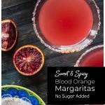 Aerial view of blood oranges, margarita glass and rimming salt.