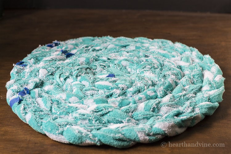 Backside of braided beach towel rug.