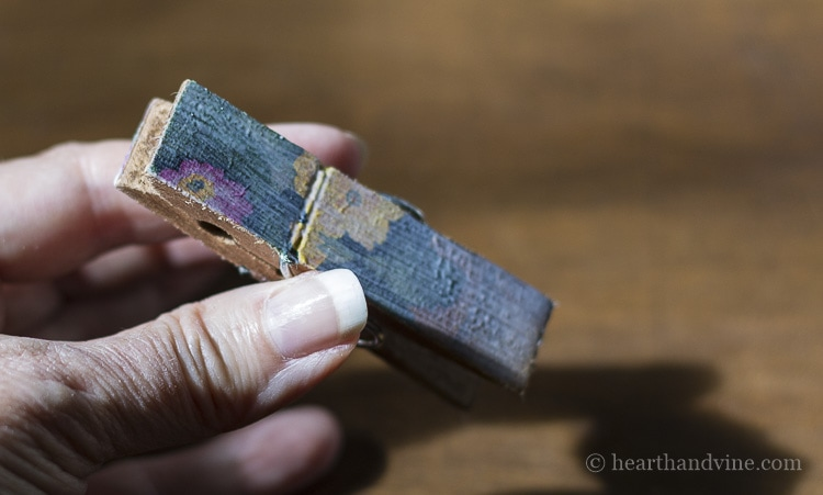Decoupaged clothespin with Mod Podge coating