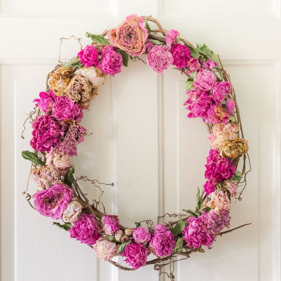 Dried peony wreath on white door.