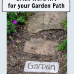 Garden path with a brick and the word Garden painted in black on white.
