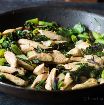 Pan with stir fried chicken, greens and snap peas.