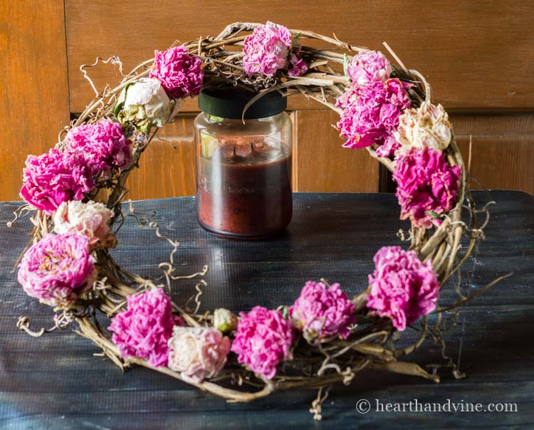 Creating the dried peony flower wreath.