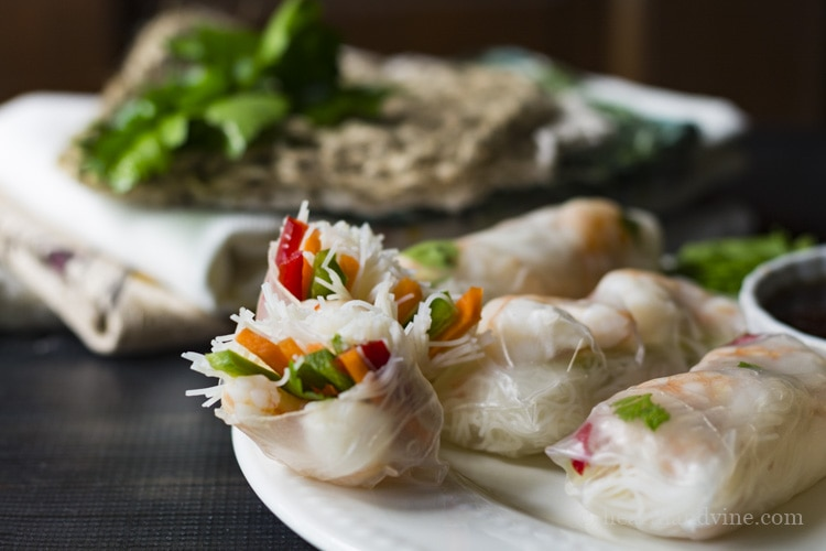 Shrimp spring roll appetizers with dipping sauce.