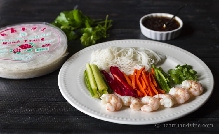 Fresh shrimp spring roll and dipping sauce ingredients.