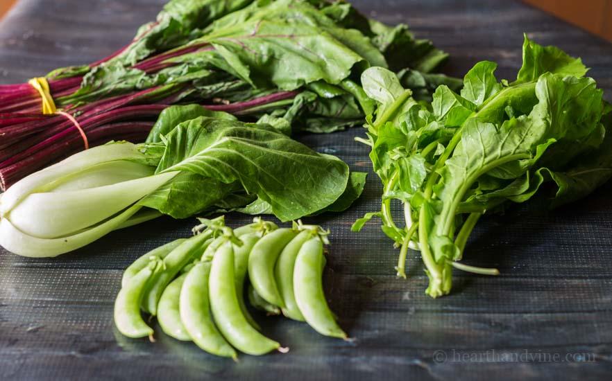 Greens and sugar snap peas.