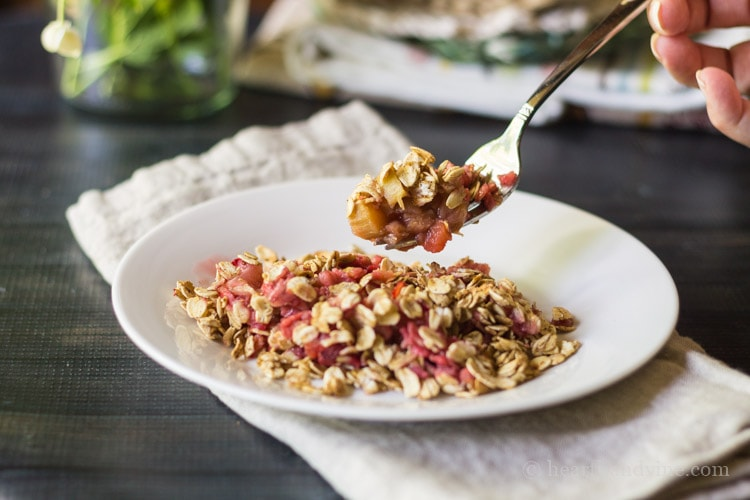 Fork full of natural sugar strawberry rhubarb crisp
