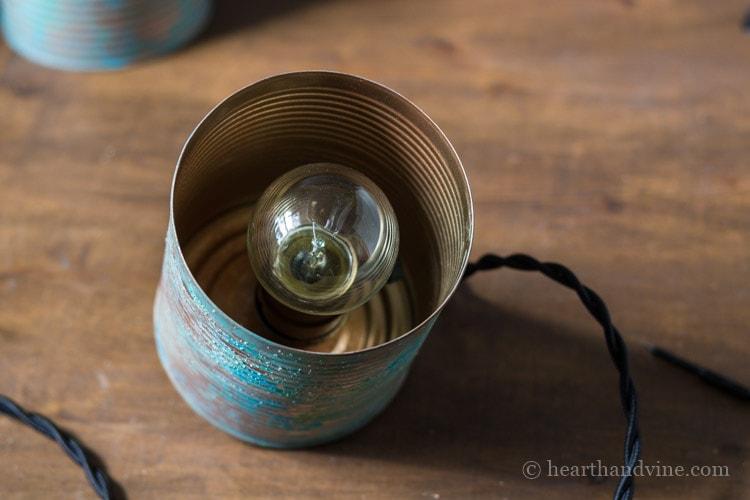 Tin can decorative bulb inside.
