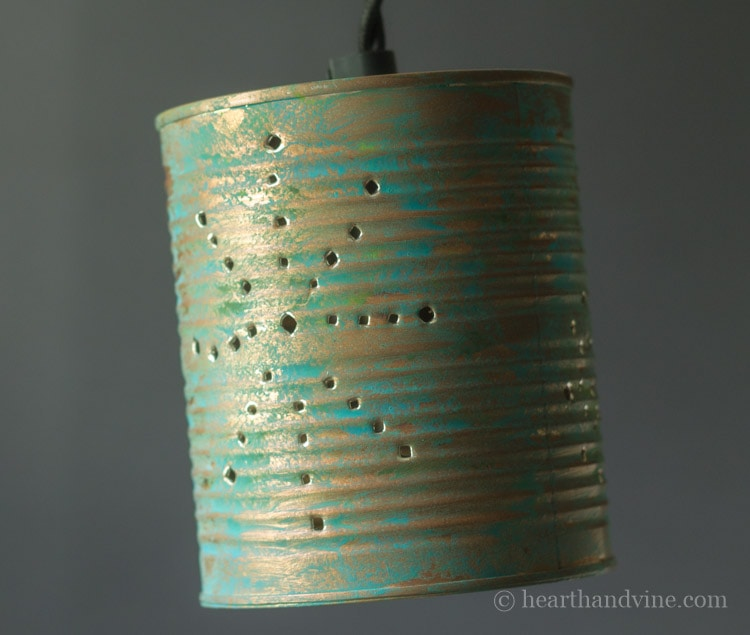 Hanging tin can lantern.