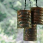 Hanging tin can pendant lights during the day.