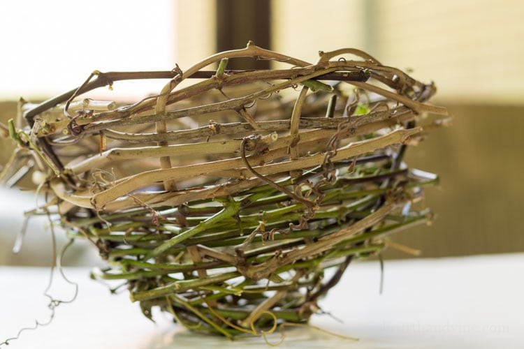 Side view of handmade grape vine basket.