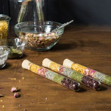 Handmade gifts of dried flowers and herbs in test tubes.