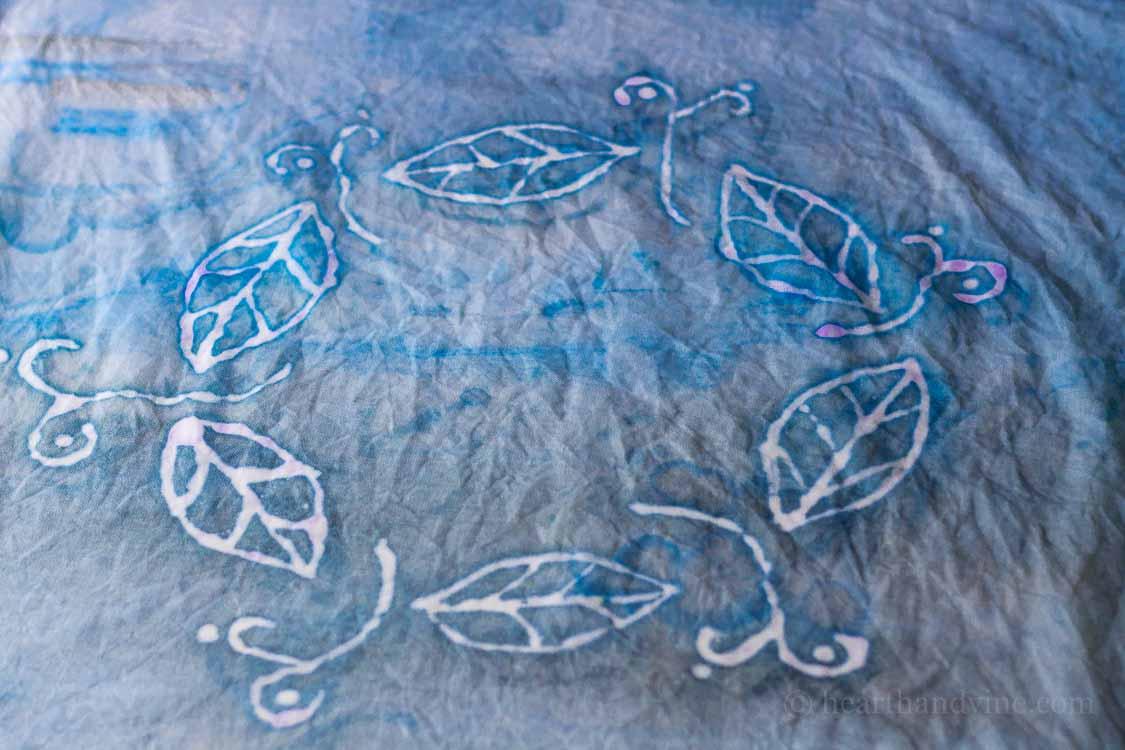 Painted fabric with glue batik print.