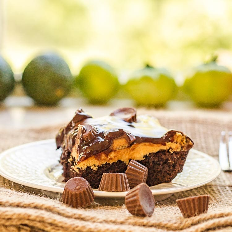 Chocolate peanut butter cake. This recipe is easy to make and so decadent with layers of cake, peanut butter and chocolate ganache.