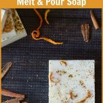 Square orange cinnamon soap with orange peels and cinnamon pieces.