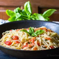Fresh tomato basil pasta is easy, and a good way to use fresh tomatoes and basil from the garden. It's so delicious you'll want to make it every night.