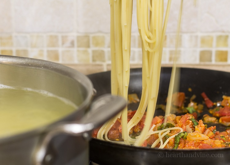 Fresh tomato basil pasta - draining the pasta.