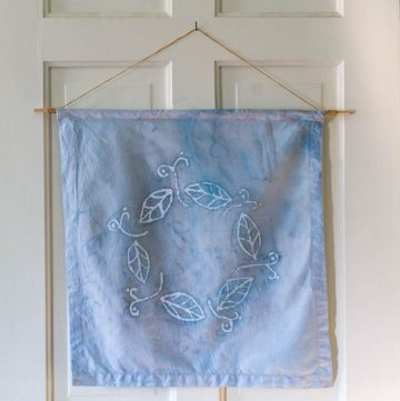 Batik fabric art is simple to create using glue and craft paint. Follow this simple tutorial to make a beautiful wall hanging.