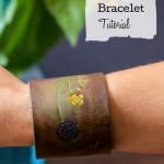 Brown leather floral engrave bracelet on arm