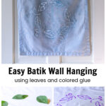Batik wall hanging over leaves on napkin and purple glue outline.
