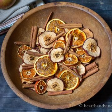 Bowl of dried oranges, apples an cinnamon sticks