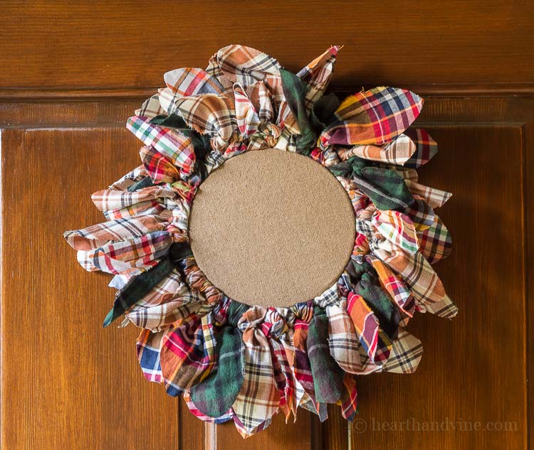 This embroidery hoop upcycled wreath on door