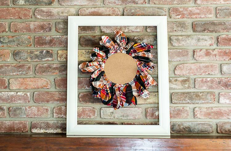 This embroidery hoop upcycled wreath framed on mantel