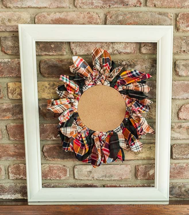 This embroidery hoop upcycled wreath is easy to make with old flannel shirts that you may have on hand or can buy at your local thrift store.