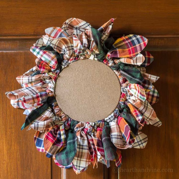 Thisembroidery hoop upcycled wreathis easy to make with old flannel shirts that you may have on hand or can buy at your local thrift store.