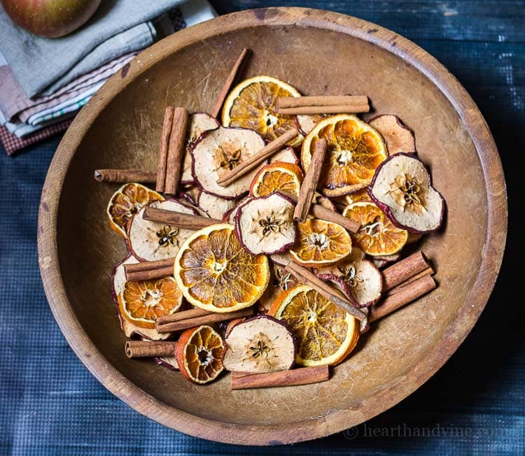 Homemade potpourri made with natural apples, orange slices and cinnamon sticks.