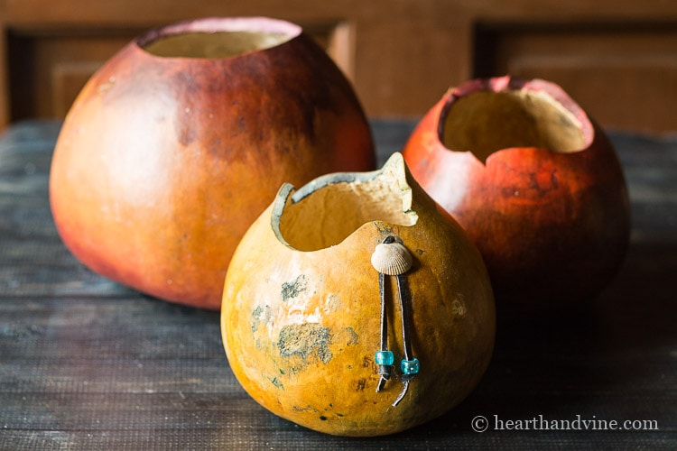 Old gourds that were cut at the top to create a bowl and painted.