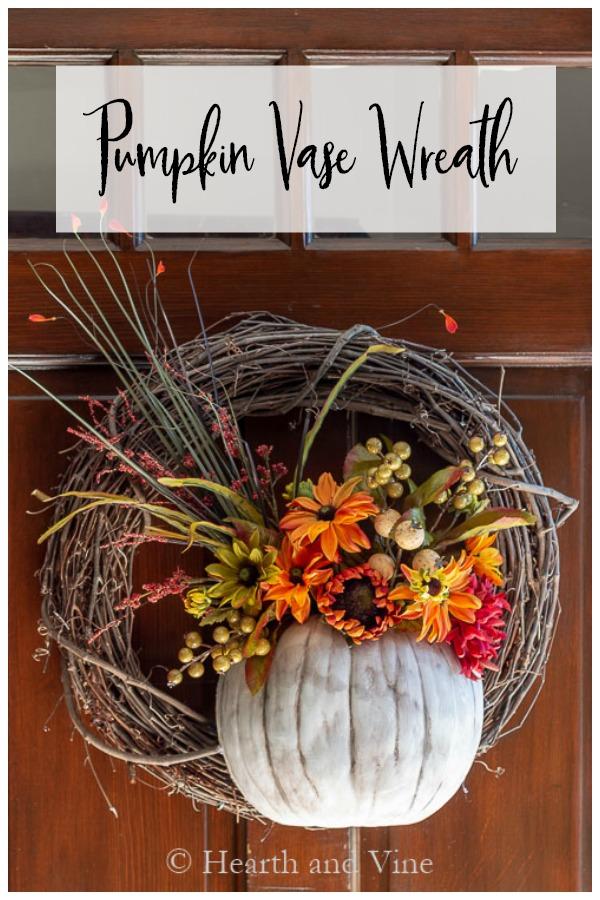 Pumpkin vase on wreath