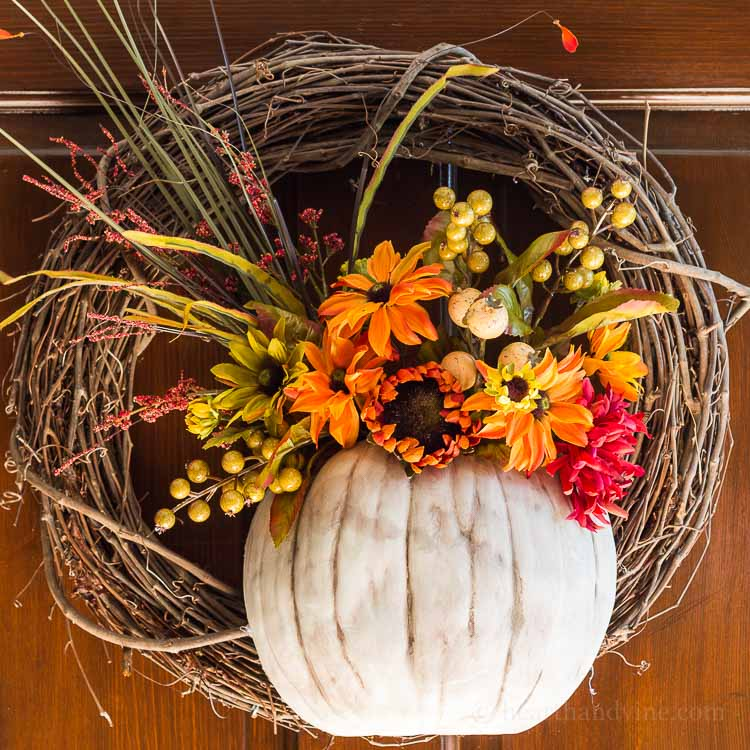 A floral pumpkin wreath perfect for a front door in the fall.