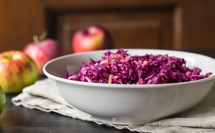 Red cabbage apple slaw is a delicious combination of with a sweet and tart crunchiness, making this a healthy and tasty side dish.