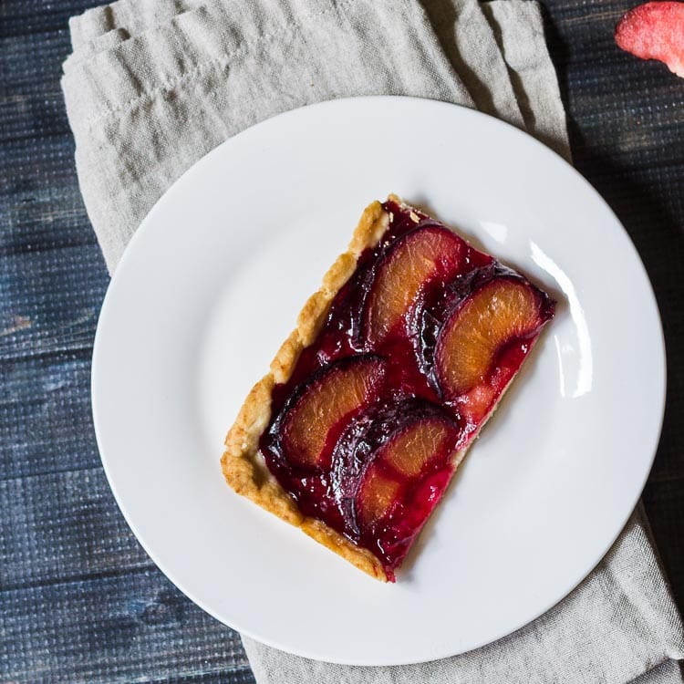 Spiced plum pie made in a rectangle slab style shape can be a beautiful rustic looking dessert that tastes as delicious as it looks.