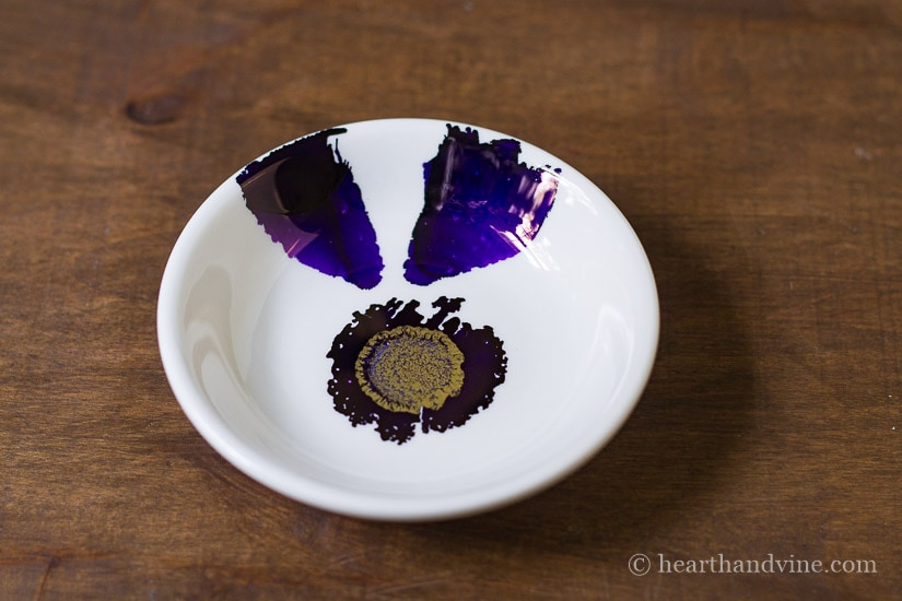 Alcohol ink flower petals with compressed air.