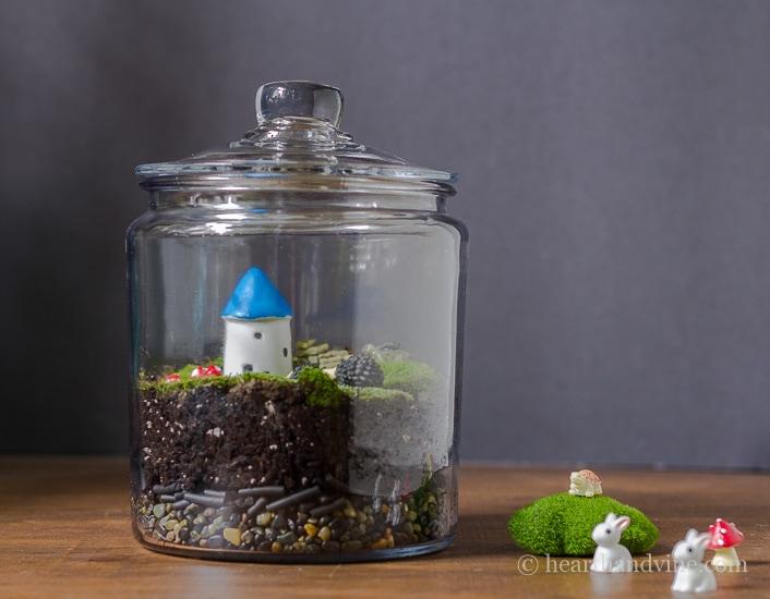 Indoor fairy garden in a terrarium jar.