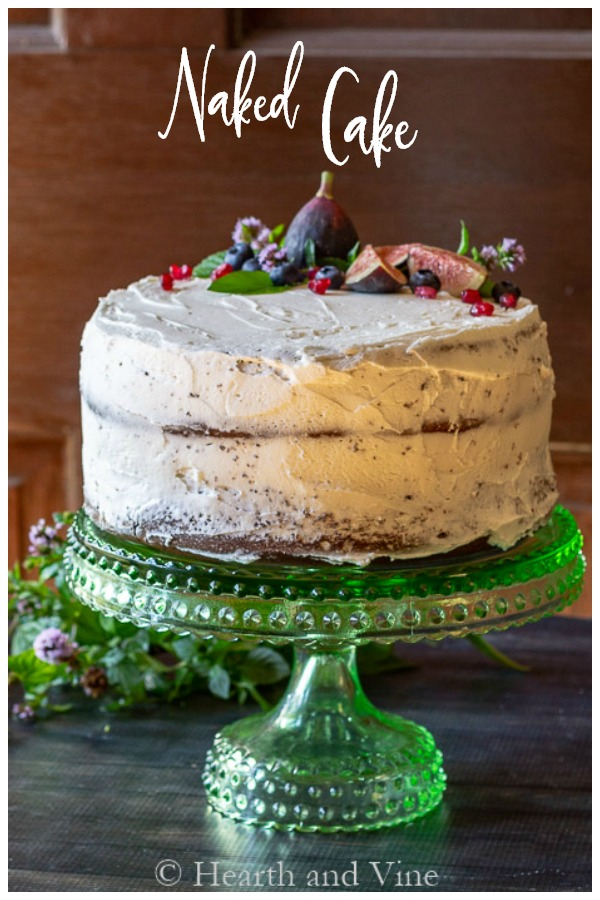 Decorated cake with minimal frosting and fresh fruits and berries