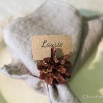 Pine cone napkins rings create natural beauty for your table any time of year. They are simple to make, and also double as name tag holders.