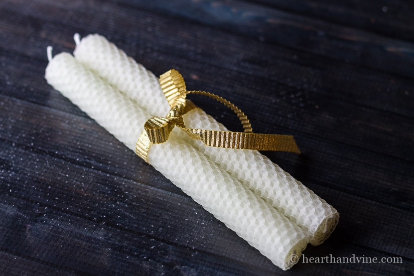Pair of rolled beeswax candles.