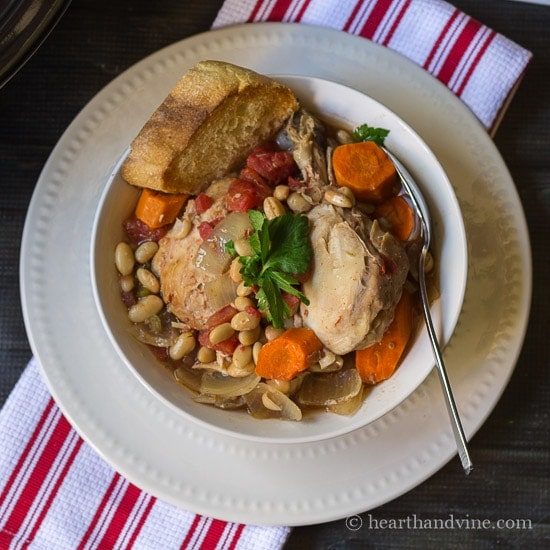 This slow cooker chicken cassoulet recipe is filled with rich bold flavors and simple ingredients, inspired by the French countryside.