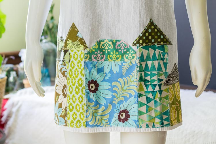 Tea towel apron - houses appliqued on bottom.