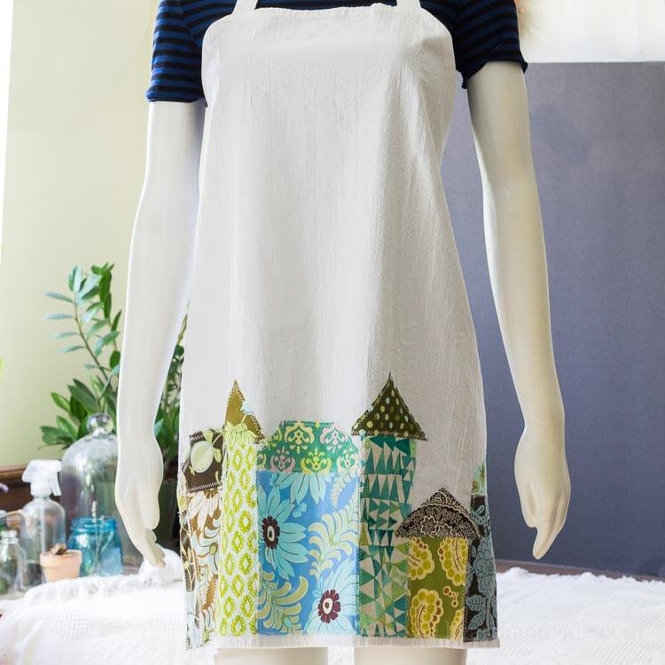 Tea towel apron on a manniquin.