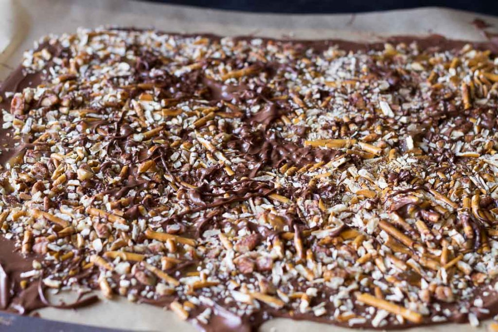 Chocolate bark with pretzels, pecans, and caramel.