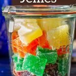 Glass jar filled with jelly candy squares in different colors..