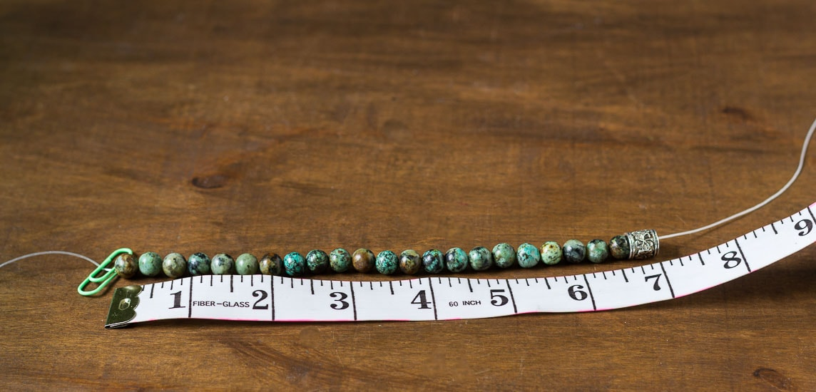 Healing stone bracelets threading beads to length.