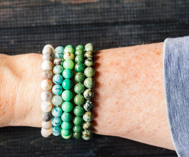 Healing stone bracelets on arm.
