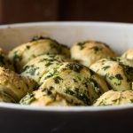 Herb dinner rolls from fresh herbs and pizza dough.